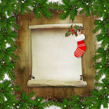 year greetings: Christmas congratulatory background with pine branches, a roll of paper for text and Christmas socks on a wooden background Stock Photo