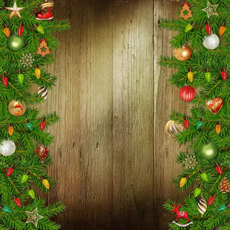 congratulatory: Christmas congratulatory background with pine branches and Christmas ornaments on the wooden background