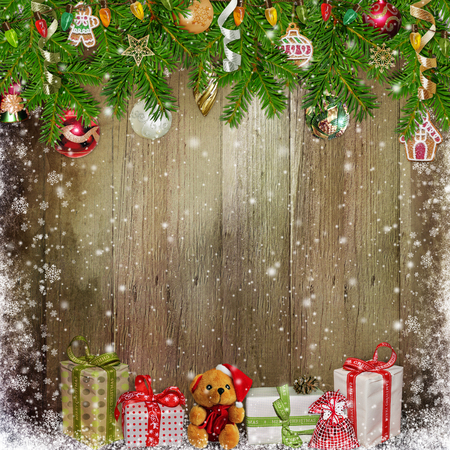 paper old: Christmas congratulation background with gifts, pine branches and Christmas ornaments on the wooden background