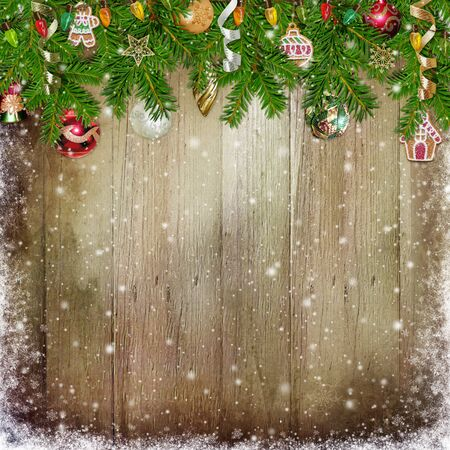 paper old: Christmas congratulation background with pine branches and Christmas ornaments on the wooden background