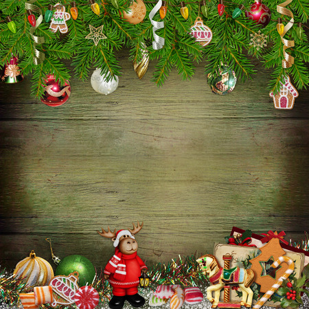 Christmas greeting background with Christmas toys, pine branches, sweets