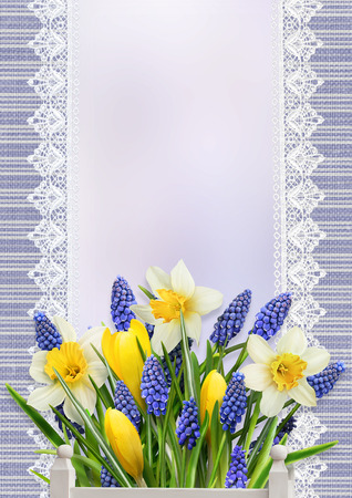 memoirs: A bouquet of flowers with space for text on vintage background with lace