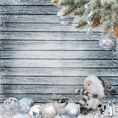 Christmas congratulatory background with snowman, pine branches and Christmas decorations
