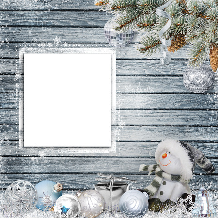 congratulatory: Christmas congratulatory background with frame for text or photo, snowman, pine branches and Christmas decorations