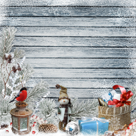 dcor: Christmas greeting background with snowman, gifts, pine branches and Christmas decorations Stock Photo
