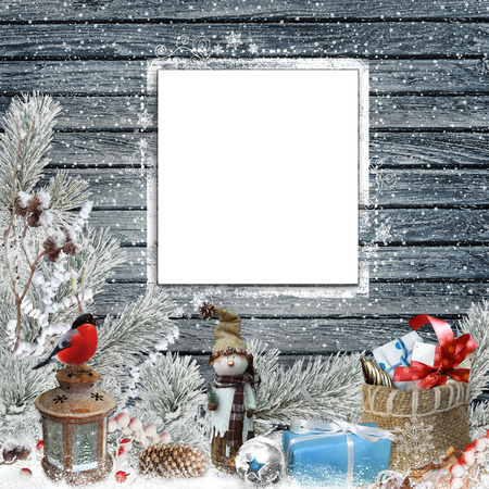 year greetings: Christmas congratulatory background with frame for text or photo, snowman, gifts, pine branches and Christmas decorations Stock Photo