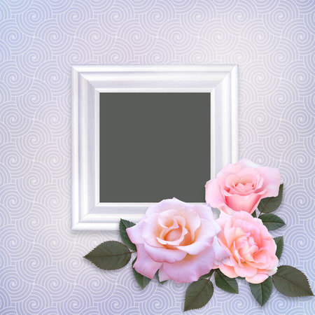 Pink roses and frame on a gentle romantic vintage background Imagens