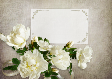 Greeting card with roses and card for text on a vintage background