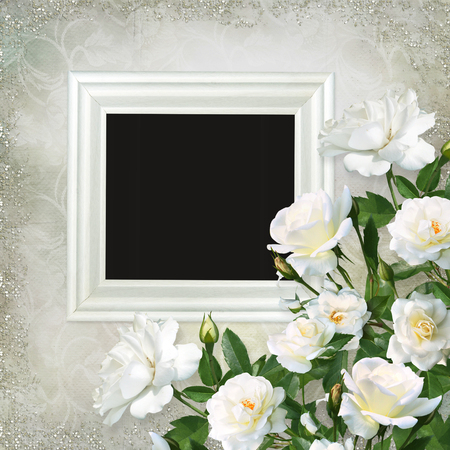 Frame and white roses on a beautiful vintage background Imagens