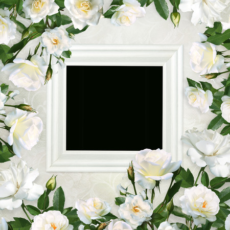 Frame for photo wrapped by white roses on a beautiful vintage background