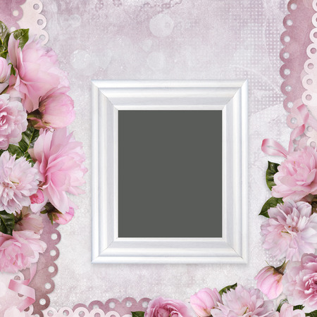Beautiful borders of pink roses and frame on a gentle romantic vintage background