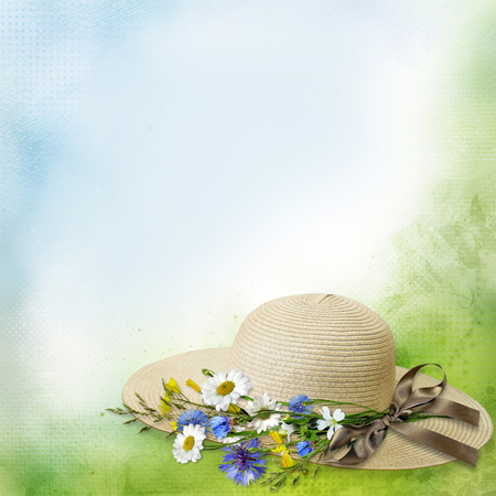 Female straw hat with ribbon and bouquet of flowers on a vintage background with space for text or photo