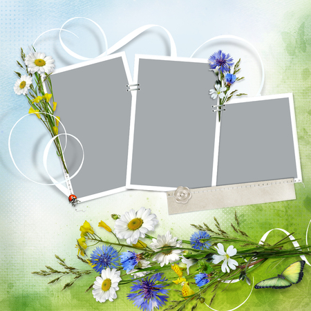 Beautiful background with frames for a photo and a bouquet of flowers from chamomiles and cornflowers