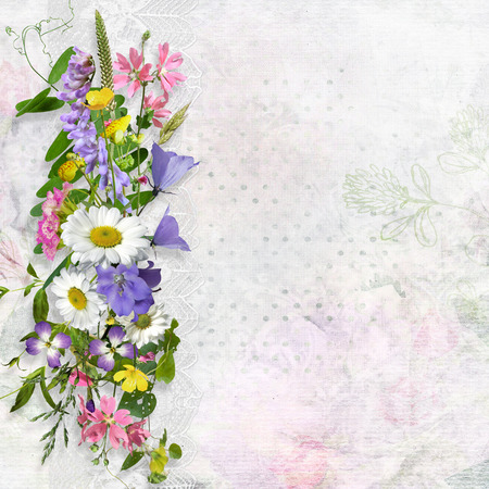 Vintage background with space for text or photo and a bouquet of summer meadow flower Imagens