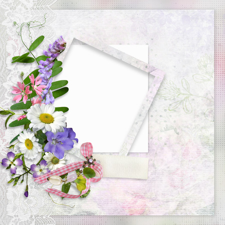 Vintage background with lace, frame for photo or text and a bouquet of summer meadow flowers