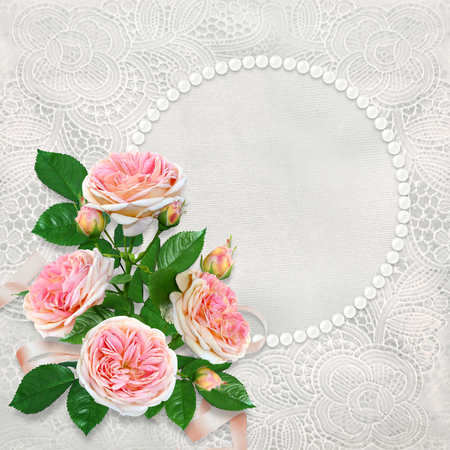 Beautiful lace background with pearl frame for text or photo and a bouquet of pink roses