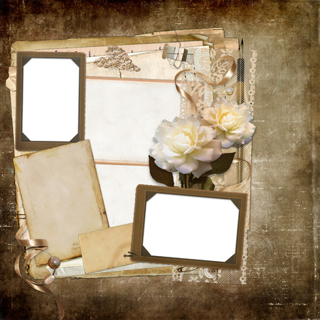 Old vintage photo frames, faded roses, ribbons, vintage jewelry, lace on a worn vintage background Standard-Bild - 116784494