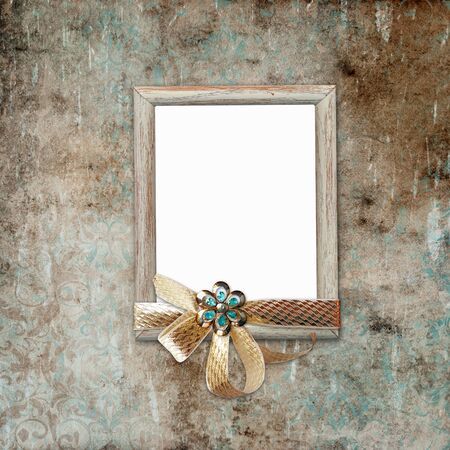 Wooden frame with ribbon and brooch on a shabby vintage background. Stok Fotoğraf