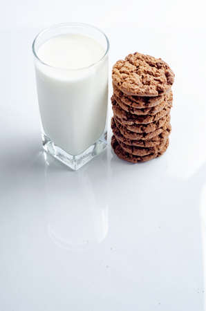 chocolate chip cookies and glass of milk on white background Stock Photo