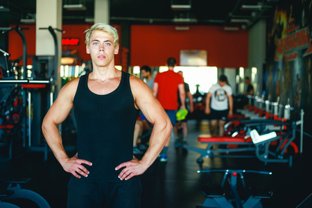 Portrait Of Smiling Muscular Man Standing In Gym Imagens