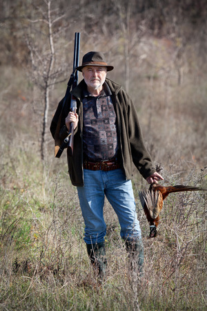 wildfowl: Hunter with a gun and wildfowl after a successful shot Stock Photo