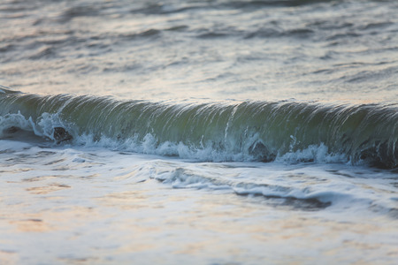 rages: Sea wave close-up on a summer morning