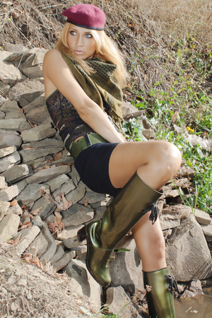 peacemaker: Girl in military style posing on nature background Stock Photo