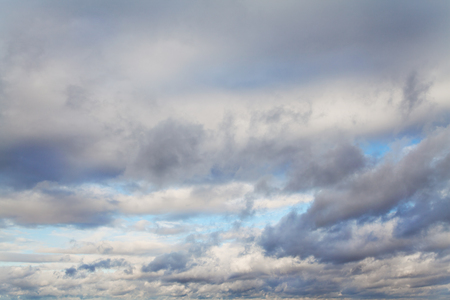 clarify: Blue sky with white and gray clouds
