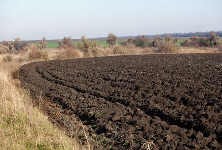 plowing: Edge of field after plowing in autumn