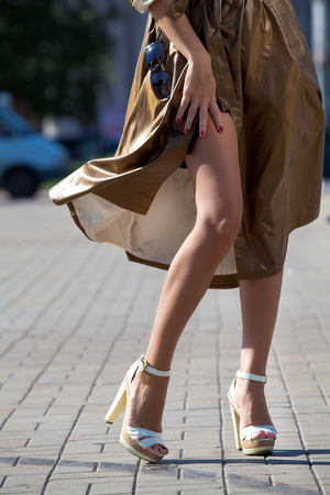 Legs and heels: Legs of beautiful girl in high heels in autumn city