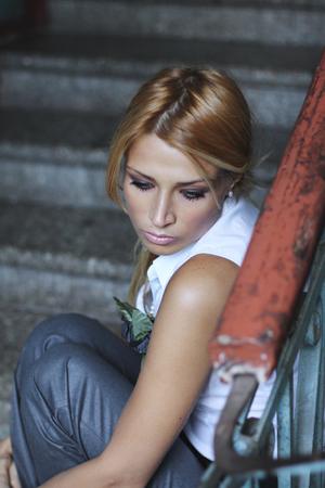 sadly: Romantic young woman sadly sadly looks down