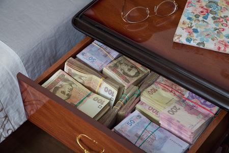 deprived: Bundles of banknotes in bedside table filled with Ukrainian cash
