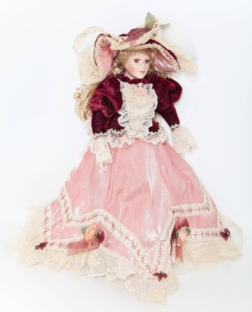 velvet dress: Doll lady in elegant velvet dress with a hat on white background