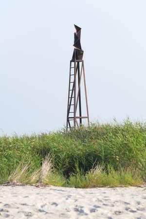 reflector: Old soviet iron reflector radar signal on the beach