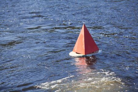 rages: Floating red buoy on the blue water
