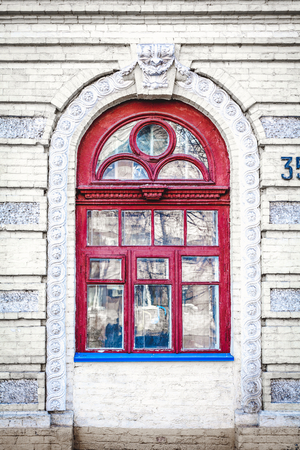 transom: Red wooden box complex shapes in an old brick building