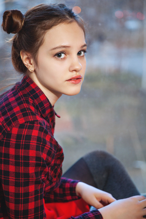 tuft: Portrait of a young girl with a tuft of hair in a red plaid shirt Stock Photo
