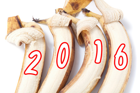partially: Four partially peeled banana on which painted figures of 2016 monkey year Stock Photo