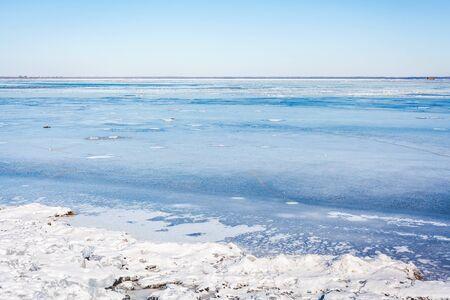 frozen river: Beautiful landscape. Wide frozen river bright sunny day