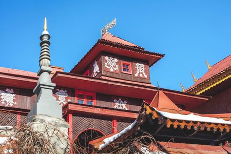 monastery: upper floor and buddhist monastery tower against the blue sky