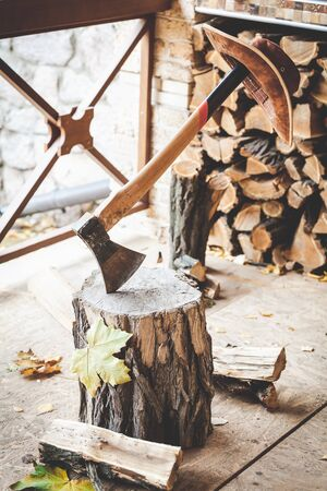 weighs: Hatchet sticking in a stump, with a long handle weighs leather hat Stock Photo