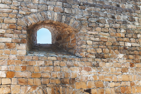 loophole: Loophole in thick stone wall of ancient fortress