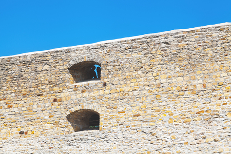 profiting: Wall of ancient medieval stone fortress of Cossacks against  blue sky