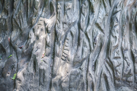 voluminous: Grey stone texture with abstract pattern of deep cuts