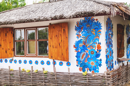 Ukrainian hut with thatched roof and beautiful pattern on wall Editorial