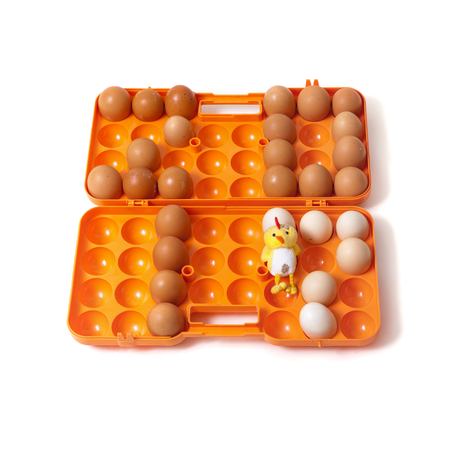 top seven: 2017. The figures of the year made up chicken eggs. Eggs are inserted into the orange plastic container of the cell beside to toy yellow chicken