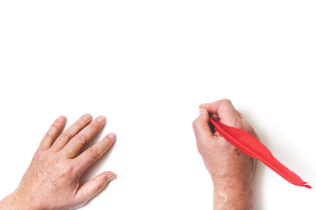 top seven: Hands painted in red digits of the year of the cock feather