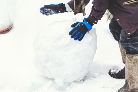 generates: Hands in gloves ski generates a large snowball winter day  Stock Photo