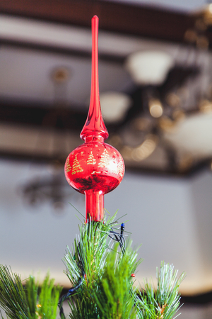 bright red tip of a long, narrow spire on a Christmas tree closeup Reklamní fotografie - 67176268