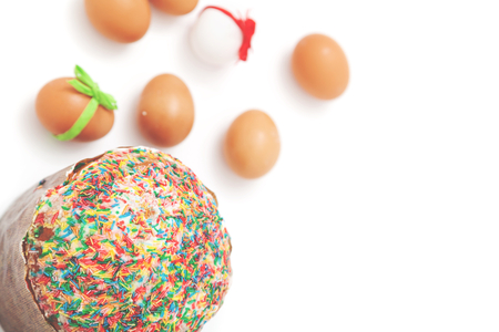 sanctified: delicious Easter cake and painted eggs with ribbons on a white background  Stock Photo